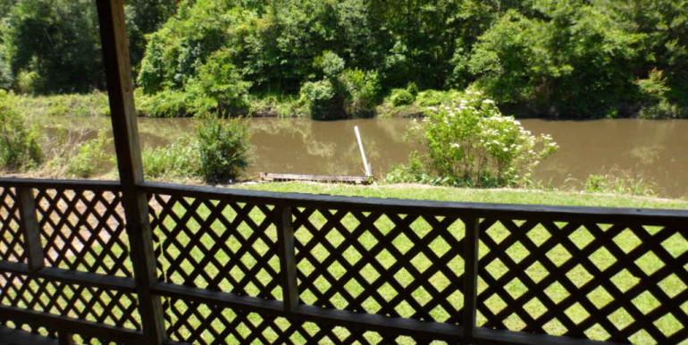 2122 Gimon Cir N Backyard and Eslava Creek From Porch