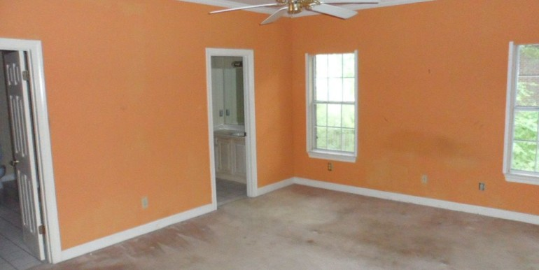 1570 Brockton Ln E Mobile AL 36695 Master Bedroom with Carpet and Ceiling Fan
