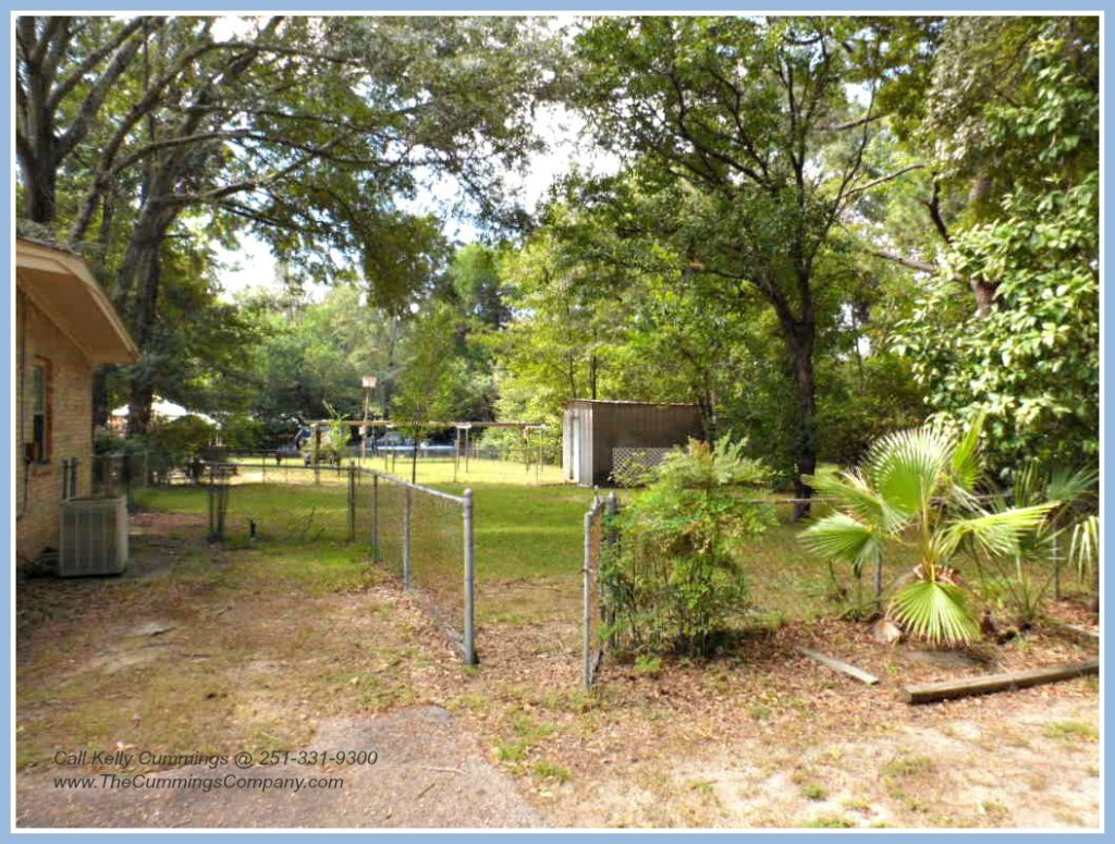 Storage Building and Fenced Backyard at Mobile AL Foreclosure Home For Sale