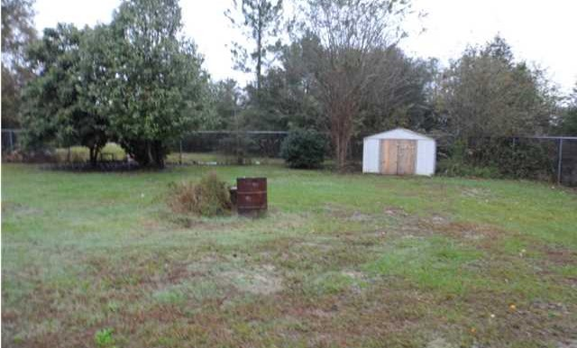 Fenced Backyard at 8060 Elizabeth St Citronelle AL 36522