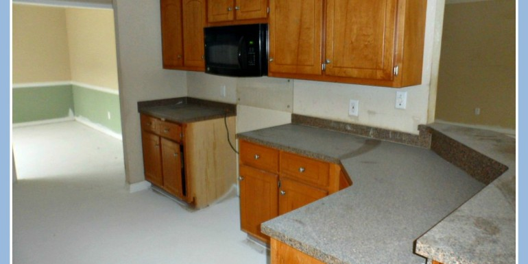 Kitchen with Breakfast Bar at 3895 Champion Cir W Mobile AL 36695