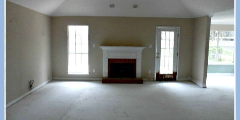 Living Room with Fireplace at 3895 Champion Cir W Mobile AL 36695