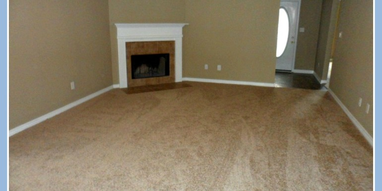 Livving Room with Fireplace at 9661 Misty Leaf Dr Mobile AL